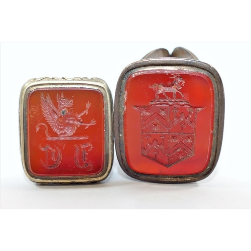 175 - Two 19th century seals, set with carnelian and carved with a coat of arms and crest, and a hexagonal...