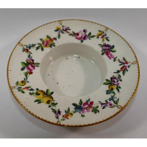 18 - An 18th century Derby porcelain trembleuse cup and saucer, hand painted in enamels with floral swags...