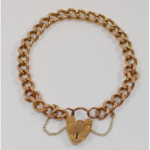 185 - A 9 carat rose gold filed curb link bracelet, with heart-shaped padlock clasp, London 1973, 23.4g...