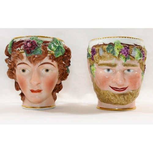 19 - Two 18th century Derby porcelain Bacchus head mugs, of a young Bacchus and a bearded Bacchus, each w...