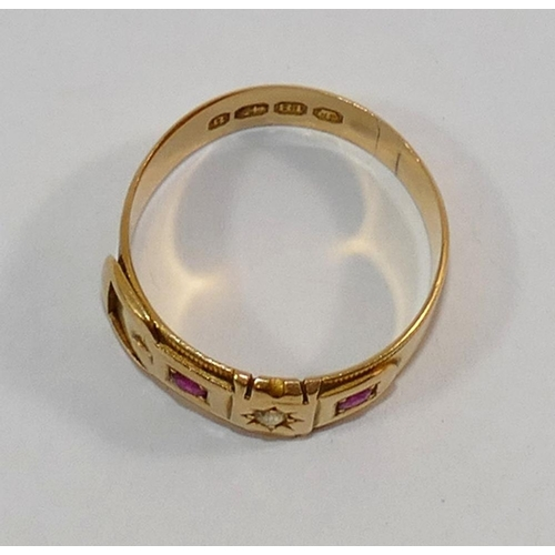 198 - A Victorian 18 carat gold ruby and diamond buckle ring, the round brilliant cut diamond approximatel...