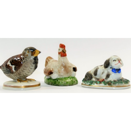 2 - A small 19th century porcelain figure of a sparrow chick on circular base with Chelsea style gold an...