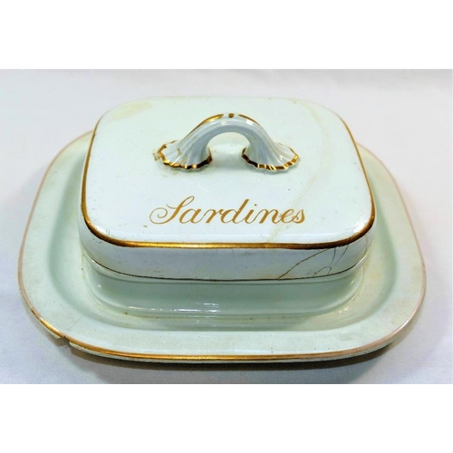 20 - A Victorian Copeland earthenware white glazed lidded sardine dish, with gilt highlights, the lid ins...