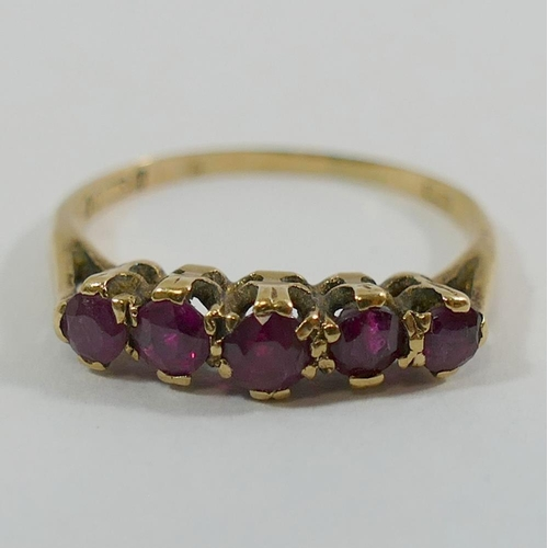 200 - A 9 carat gold almandine garnet five stone ring, London 1963, the round mixed cut stones in claw set...