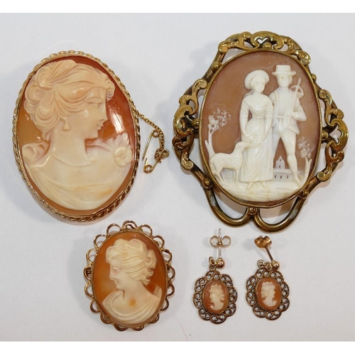 203 - A Victorian pinchback shell cameo brooch carved with a sweetheart scene of a shepherd and his belove...