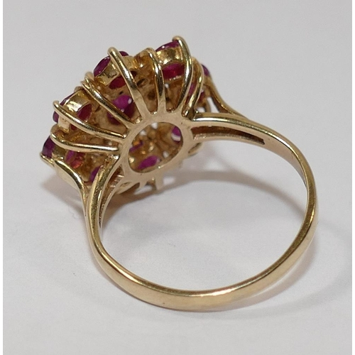 208 - A 9 carat gold ruby and diamond circular cluster ring, the circular and oval mixed cut rubies in cla...