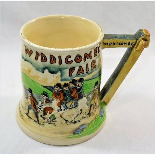 21 - A Crown Devon Fieldings 'Widdecombe Fair' musical mug, 11.5cm high...