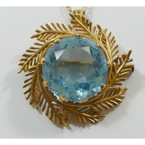 212 - A yellow metal blue paste set pendant brooch, the circular stone with fern surround, unmarked, 11.5g...