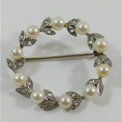 215 - A diamond and cultured pearl circular wreath brooch, the 10 cultured pearls interspersed with diamon...