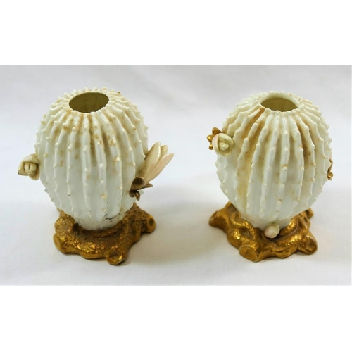 22 - A pair of small Victorian Moore Brothers porcelain cactus vases, on gilt bases, 8.8cm high...
