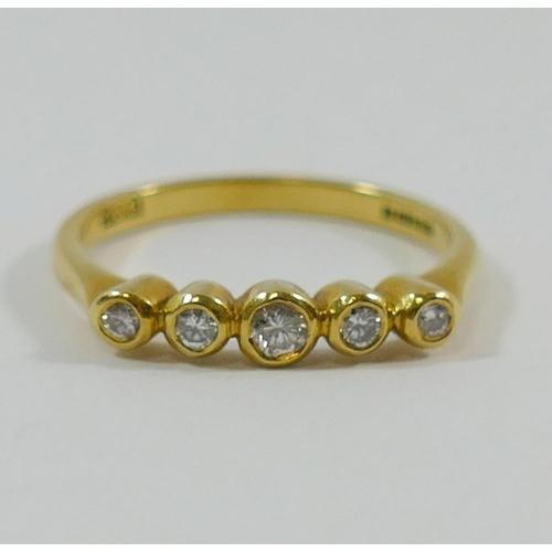 224 - An 18 carat gold diamond five stone ring, the graduated small round brilliant cut diamonds in indivi...