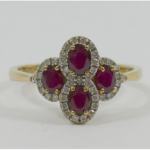 227 - A 9 carat gold ruby and diamond cocktail ring, comprised of four oval clusters, Birmingham 2009, the...