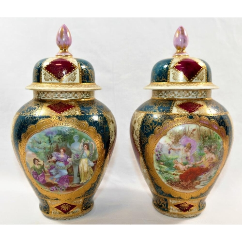 23 - A pair porcelain lidded vases, with transfer decorated figural scenes and green, ivory and red panel...