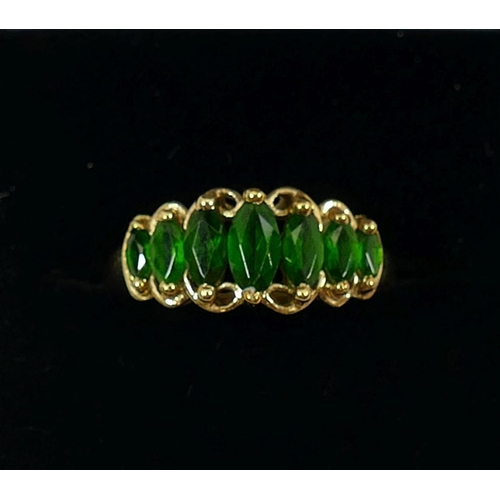 233 - A 9 carat gold seven stone chromium diopside ring, Birmingham 2009, the graduated marquise-shaped gr...