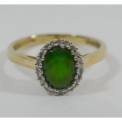 237 - A 9 carat gold chrome diopside and diamond oval cluster ring, Birmingham 2009, the bright green oval...