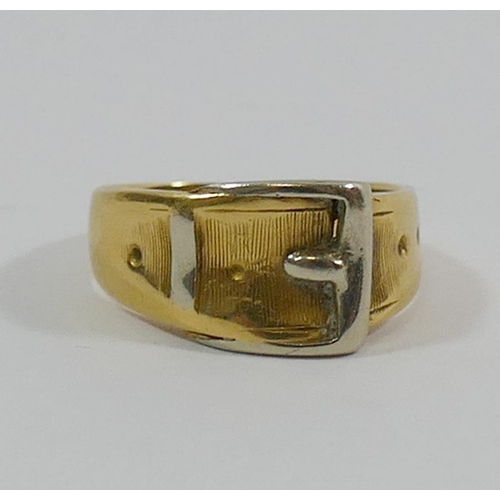 239 - A bi-colour buckle ring, the shank stamped '750', finger size J, 5.5g, boxed...