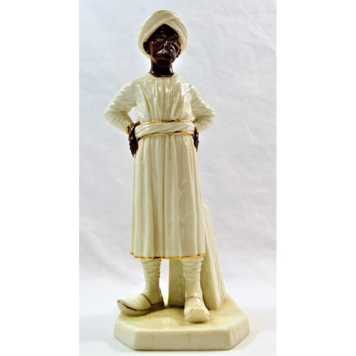 24 - A Worcester porcelain figure of an Indian gentleman standing with his hands on his hips, wearing a t...