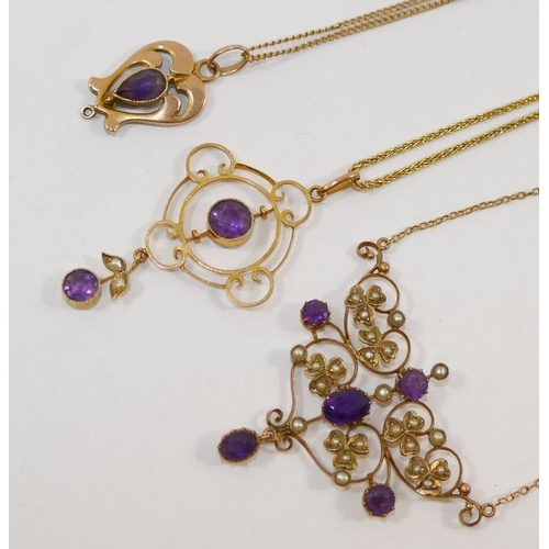 242 - An Edwardian amethyst set openwork pendant, with seed pearl and amethyst pendant drop, stamped '9CT'...