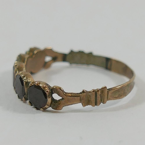 244 - A Georgian garnet five stone ring, finger size O, and a simulated aquamarine paste single stone ring...
