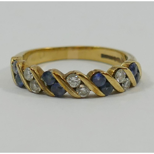 249 - A 9 carat gold sapphire and diamond half eternity ring, the small round mixed cut sapphires chanel s...