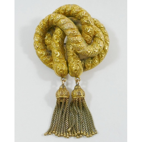 254 - A large Victorian pinchbeck rope knot brooch, 4.8cm across, another oval Victorian pinchbeck brooch ...