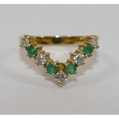 255 - An 18 carat gold emerald and diamond wishbone ring, London 1989, the five round brilliant cut diamon...