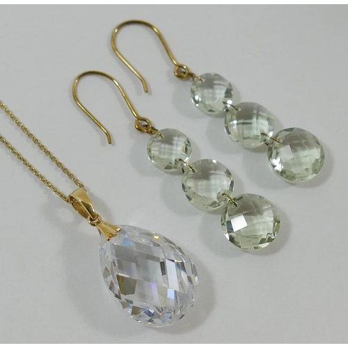 257 - A pair of facetted rock crystal drop earrings, the yellow metal hook backs stamped '375', 4.2cm long...