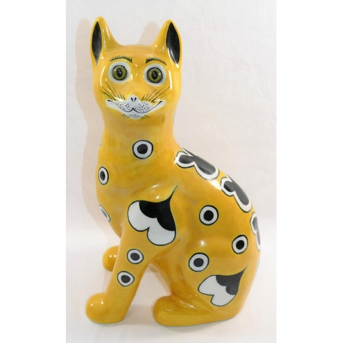 26 - A Wemyss Ware style pottery cat by Griselda Hill, with glass eyes, potters signature to base, 33.5cm...