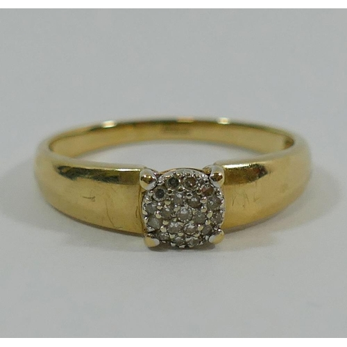 263 - A 9 carat gold diamond panel ring, the small eight-cut and baguette cut diamonds claw set in rows, t...