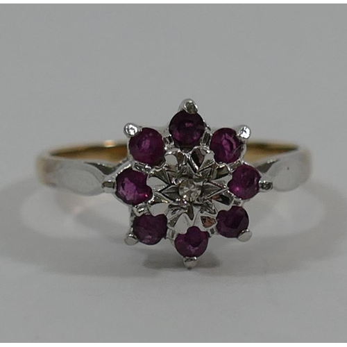 265 - A 9 carat gold ruby and diamond flower head cluster ring, set in white and yellow, and a 9 carat whi...