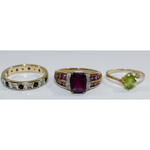267 - A 9 carat gold diamond and almandine garnet ring, Birmingham 2007, the cushion-shaped mixed cut cent...