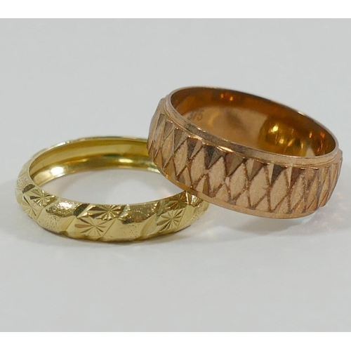 275 - A 9 carat rose gold band, with raised repeating geometric design, and another 9 carat gold band deco...