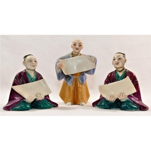 28 - Three 19th century Worcester porcelain menu holders in the form of oriental figures holding scrolls,...