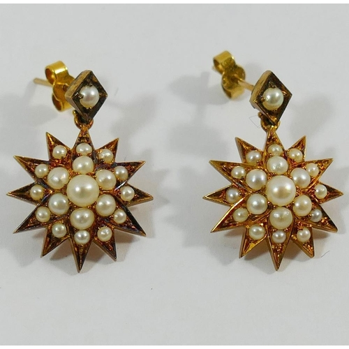 283 - A pair of Victorian half pearl set star burst drop earrings, 2.4cm long, with stick backs, unmarked...