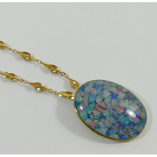 284 - An oval opal chip triplet pendant in yellow metal mount stamped '9K', 3cm long, and a 9 carat gold t...