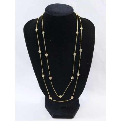 286 - Two matching 9 carat gold chains with bi-colour disks, 49cm long and 45cm long, combined weight 7.8g...