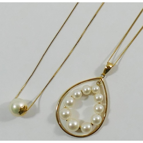 288 - A 14 carat gold mounted cultured pearl pendant on a fine box link chain, 45cm long 2.1g gross, and a...