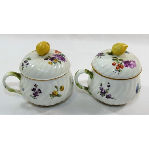 29 - A pair of 19th century Meissen porcelain custard cups and lids, hand painted with floral sprays, wit...