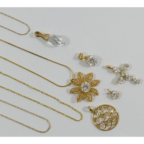 290 - A 14 carat gold flower head cubic zirconia set pendant and chain and two other 14 carat gold and cub...