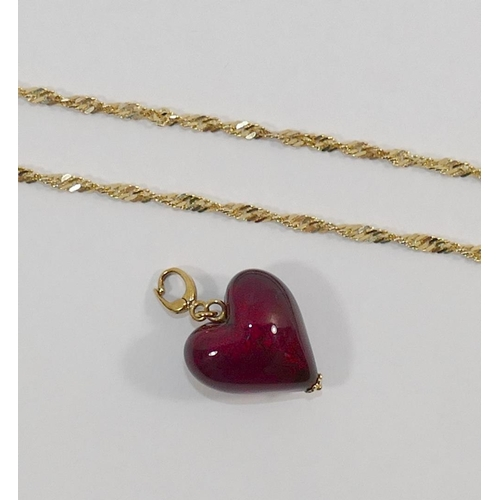 294 - A red glass heart pendant/charm with yellow metal mounts stamped '375', 3.4cm, and a 9 carat gold fl...