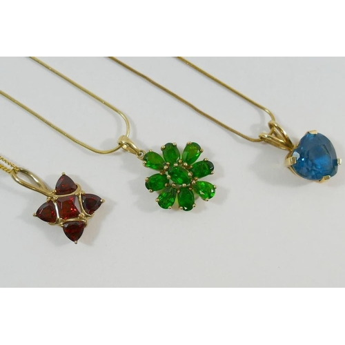 298 - Three 9 carat gold pendants and chains, set with garnet, blue topaz and chromium diopside, combined ...