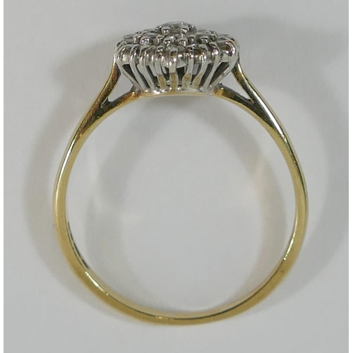 306 - A 9 carat gold diamond hexagonal cluster ring, the 19 small round brilliant cut diamonds combined we...