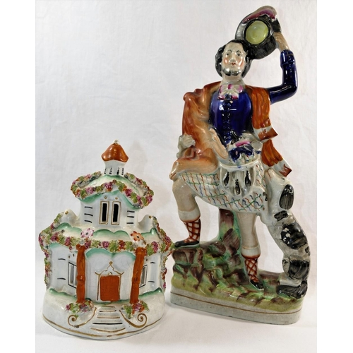 31 - A 19th century Staffordshire flatback figure of a Scottish huntsman with deer over his shoulder, spa...