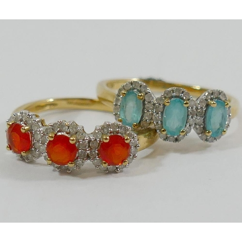 312 - A 9 carat gold blue topaz and diamond triple cluster ring, and a 9 carat gold fire opal and diamond ...