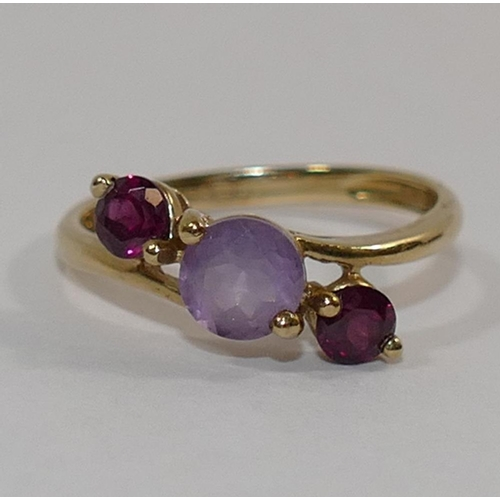 316 - A 9 carat gold garnet and amethyst three-stone cross over ring, finger size P, 2.1g gross, and a 9 c...