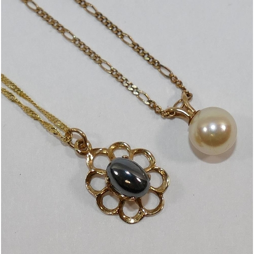 321 - A yellow metal hematite set pendant and chain, stamped '375', 1.6g gross and a cultured pearl pendan...