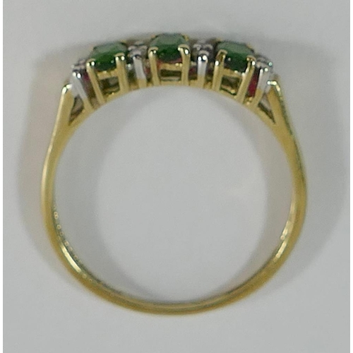 324 - Two 9 carat gold green chrome diopside and diamond dress rings, and a 9 carat gold three stone green...