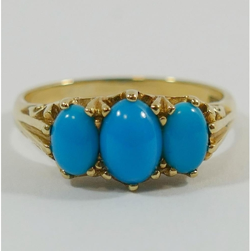 326 - A 9 carat gold three stone turquoise set ring, with ornately pierced and cast gallery, finger size O...