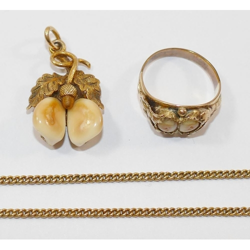 331 - A 19th century gold oak leaves and acorn pendant, set with two deer teeth stamped '585', 3.2cm long ...
