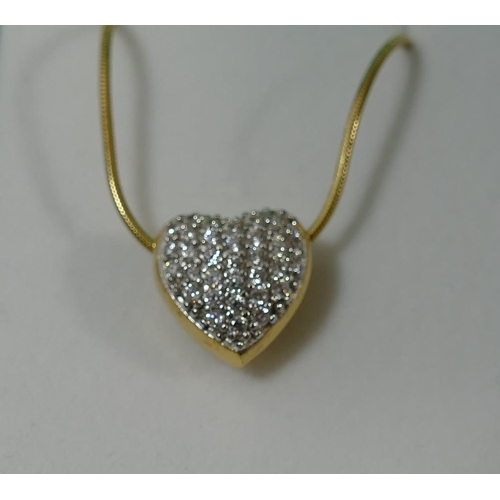 334 - A heart-shaped gold plated gem set pendant and chain, both stamped '925' the pendant stamped 'CZ', f...